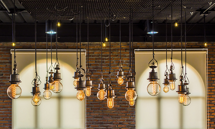 vintage tungsten light with brick wall and window background,interior loft style