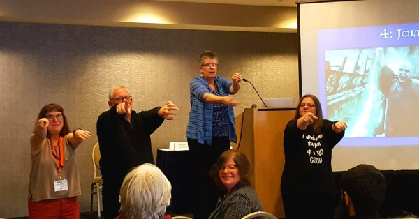 Beth, John, Jeanne and Cindy leading the audience in a JOLT exercise. Photo by Paula Jones.