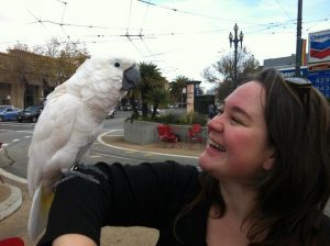 Picture of Lyndal and a parrot on her arm.