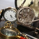 Hour workshop. Vintage still life with ancient silver pocket watch