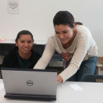 A student at the Adult Education Online Learning Lab getting personal assistance from DIF Fellow Sol Katia Jimenez.