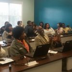 Participants learn new skills at a digital literacy class.