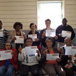 NTEN Digital Inclusion Fellowship participants hold up their certificates and new USB drive for Margo Scurry, the Fellow at Charlotte Mecklenburg Library, North Carolina.