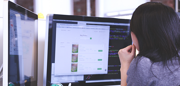 woman at computer thinking about email fundraising