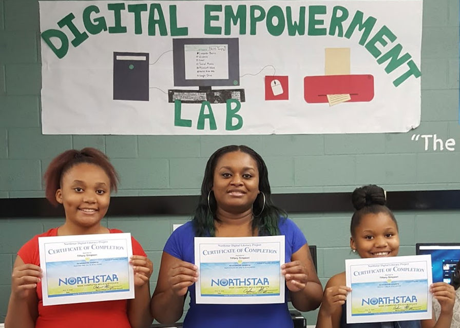 3 people hold certificates earned from the Digital Empowerment Lab