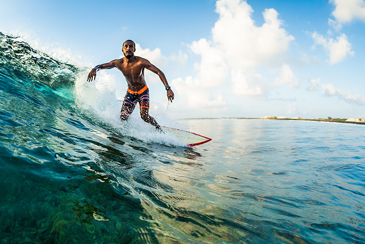 Shutterstock image of a surfer riding a wave