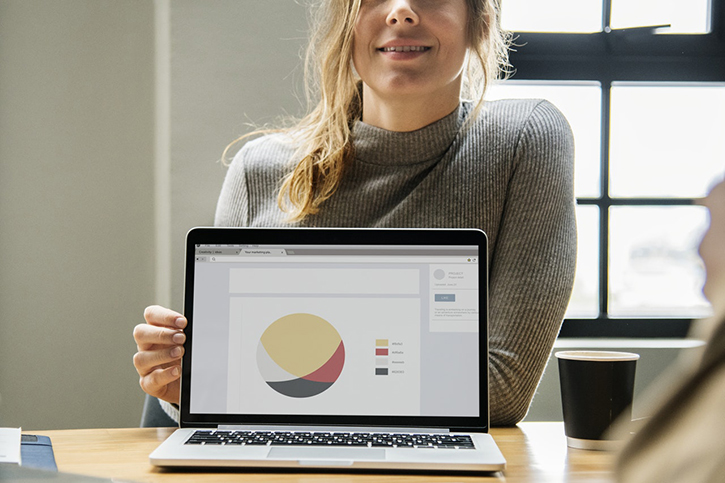 Woman showing chart on laptop