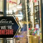 "Store sign with text ""Come in We're awesome"""