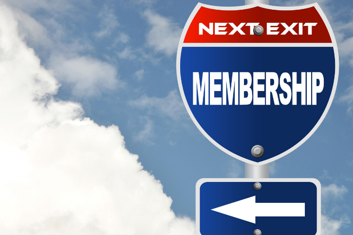 road sign pointing towards membership as the next stop