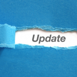 "Blue paper torn back in the middle to reveal the word ""Update."""