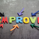 The word Improve in colorful letters surrounded by colorful arrows pointing at it