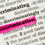 "A page of the dictionary with word ""discrimination"" highlighted in pink"