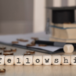 """""""Fellowship"""" spelled out in lettered dice."""