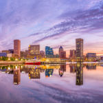 Baltimore's waterfront skyline with a purplish hue