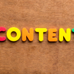 """""""CONTENT"""" spelled out in colorful letter magnets"""
