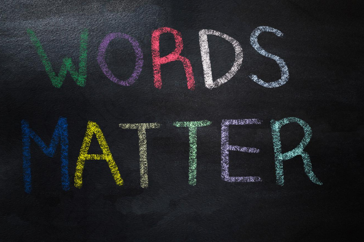 WORDS MATTER with each letter written in a different color and on a black background