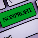 """""""Nonprofit"""" on a green button on a computer keyboard"""