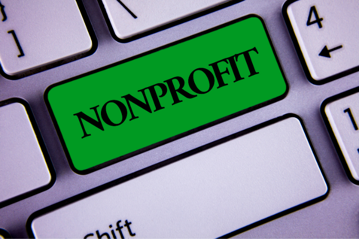 Nonprofit on a green button on a computer keyboard