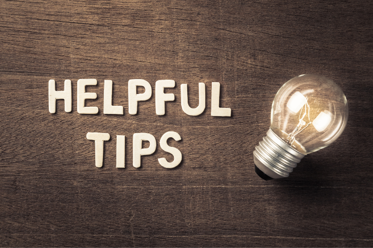Helpful tips is written in cut-out letters next to an incandescent light bulb.